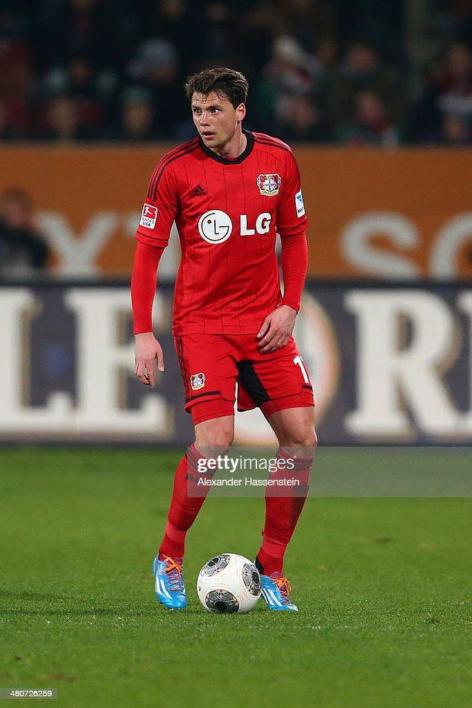 <a gi-track='captionPersonalityLinkClicked' href=/galleries/search?phrase=Sebastian+Boenisch&family=editorial&specificpeople=632472 ng-click='$event.stopPropagation()'>Sebastian Boenisch</a> of Leverkusen runs with the ball during the Bundesliga match between FC Augsburg and Bayer Leverkusen at SGL Arena on March 26, 2014 in Augsburg, Germany.
