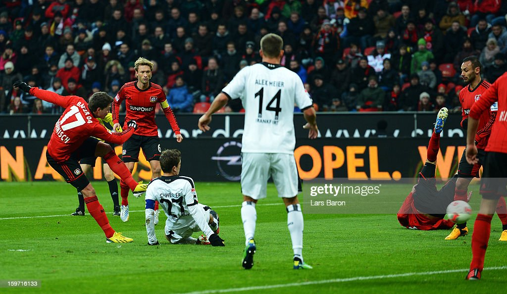<a gi-track='captionPersonalityLinkClicked' href=/galleries/search?phrase=Sebastian+Boenisch&family=editorial&specificpeople=632472 ng-click='$event.stopPropagation()'>Sebastian Boenisch</a> of Leverkusen scores his teams first goal during the Bundesliga match between Bayer 04 Leverkusen and Eintracht Frankfurt at BayArena on January 19, 2013 in Leverkusen, Germany.