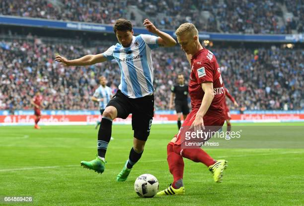 Sebastian Boenisch of TSV 1860 Muenchen challenges Timo Baumgartl of VfB Stuttgart during the Second Bundesliga match between TSV 1860 Muenchen and...