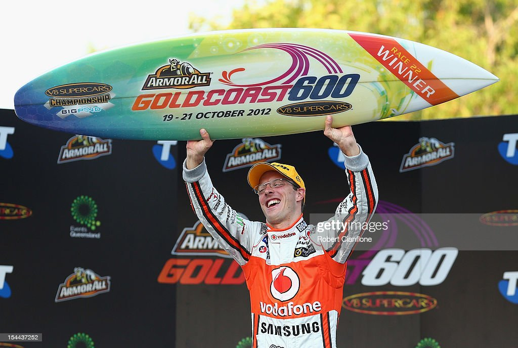 Sebastian Bourdais of France and driver of the #1 Team Vodafone Holden celebrates after he and Jamie Whincup won race 22 for the Gold Coast 600, which is round 12 of the V8 Supercars Championship Series at the Gold Coast Street Circuit on October 20, 2012 on the Gold Coast, Australia.