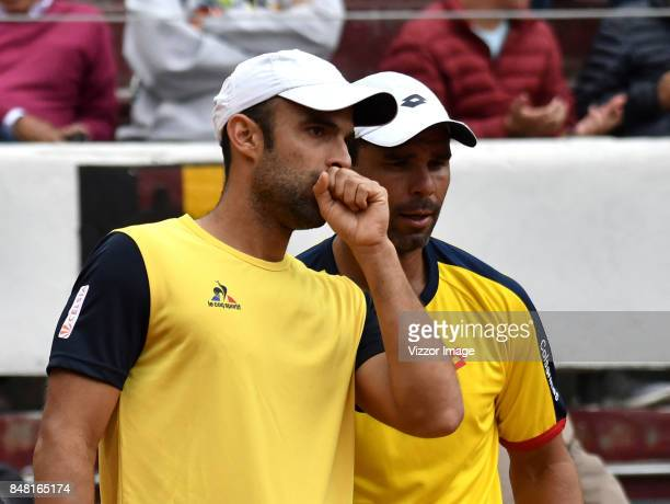 Sebastian Cabal and Alejandro Falla of Colombia talk during a doubles match against Santiago Giraldo of Colombia as part of Davis Cup at La...