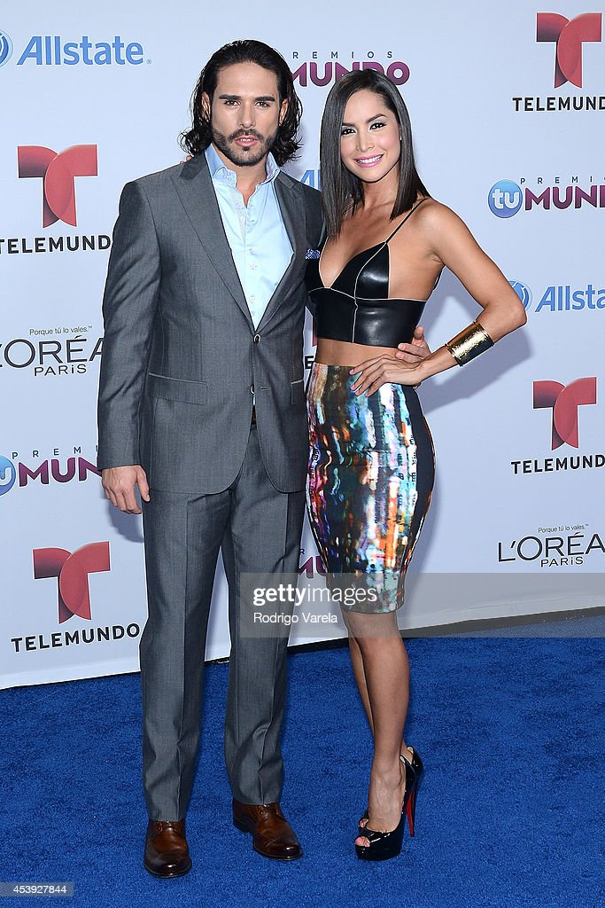 Sebastian Caicedo and Carmen Villalobo arrives at Premios Tu Mundo Awards at American Airlines Arena on August 21, 2014 in Miami, Florida.