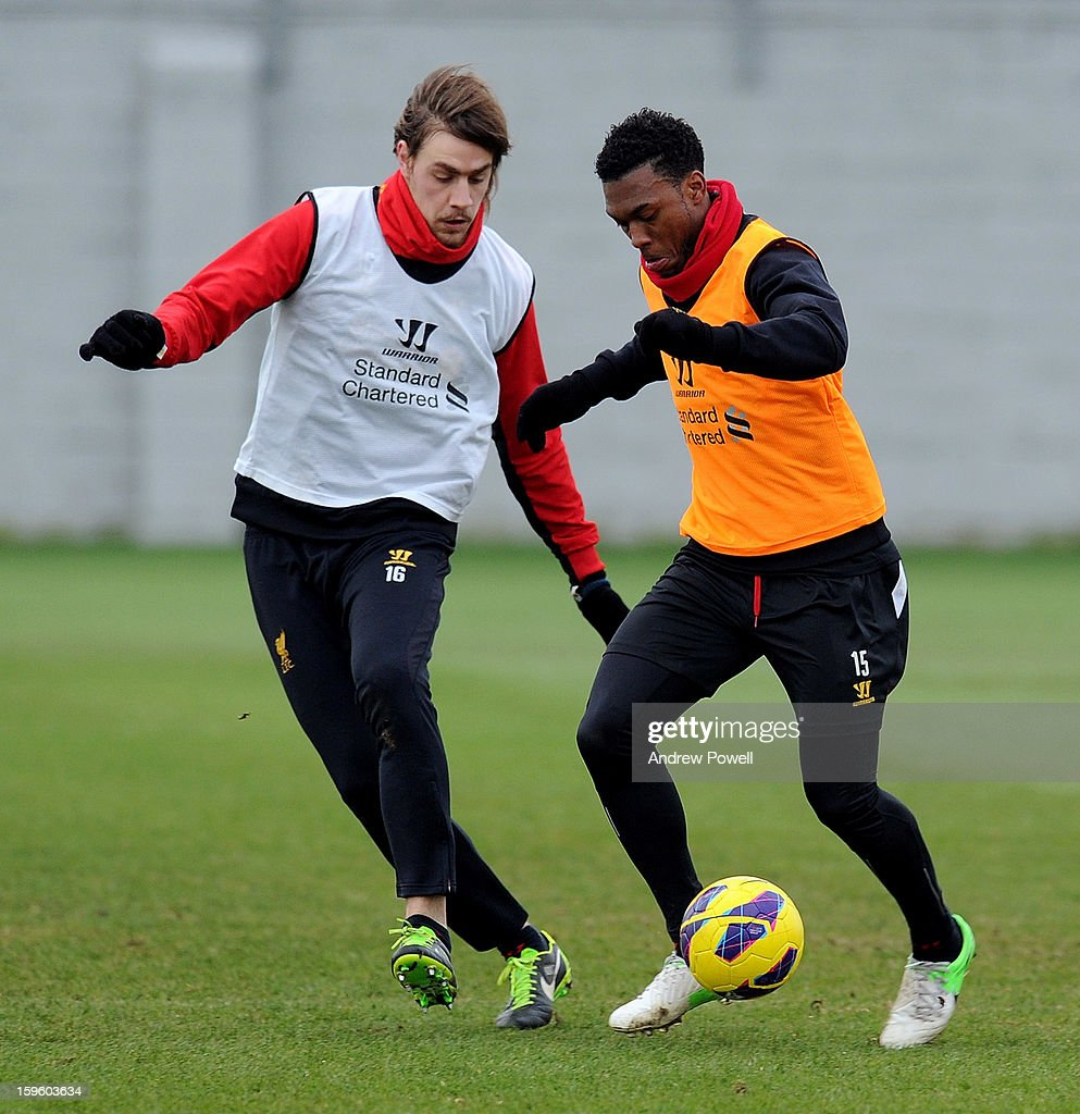 Sebastian Coates and Daniel Sturridge of Liverpool in action during a training session at Melwood Training Ground on January 17, 2013 in Liverpool, England.