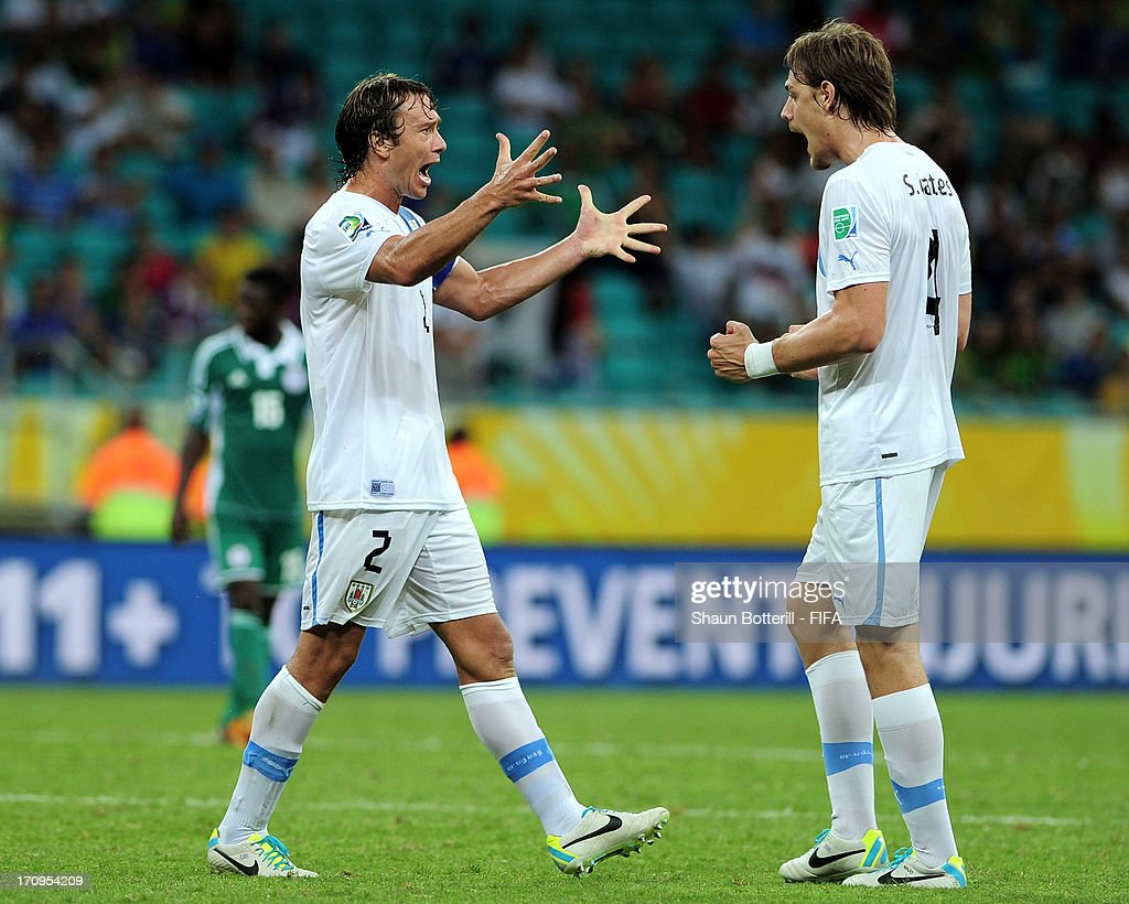 Sebastian Coates and Diego Lugano of Uruguay celebrate victory after the FIFA Confederations Cup Brazil 2013 Group B match between Nigeria and...