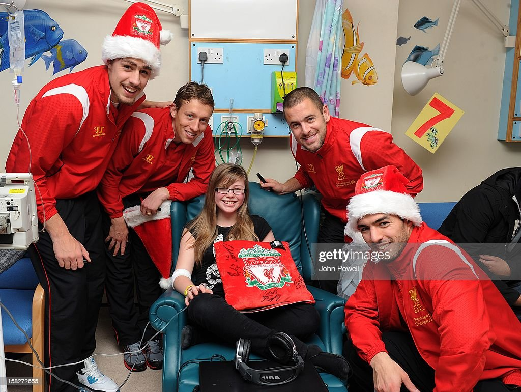 Sebastian Coates, Lucas Leiva, Joe Cole and Luis Suarez of Liverpool FC visit Alder Hey Children's Hospital on December 12, 2012 in Liverpool, England.