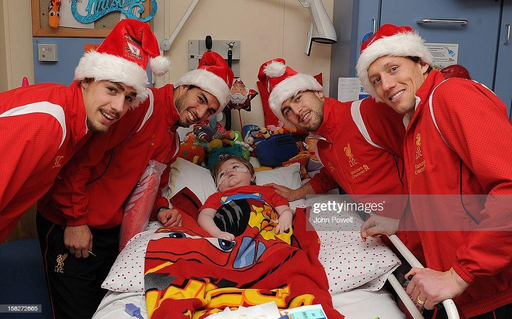 Sebastian Coates, Luis Suarez, Joe Cole and Lucas Leiva of Liverpool FC visit Alder Hey Children's Hospital on December 12, 2012 in Liverpool, England.