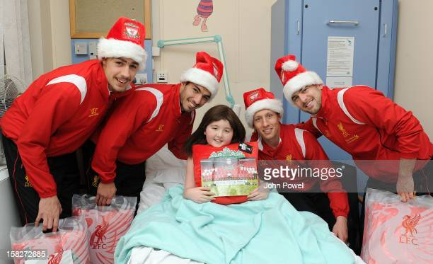 Sebastian Coates Luis Suarez Lucas Leiva and Joe Cole of Liverpool FC visit Alder Hey Children's Hospital on December 12 2012 in Liverpool England