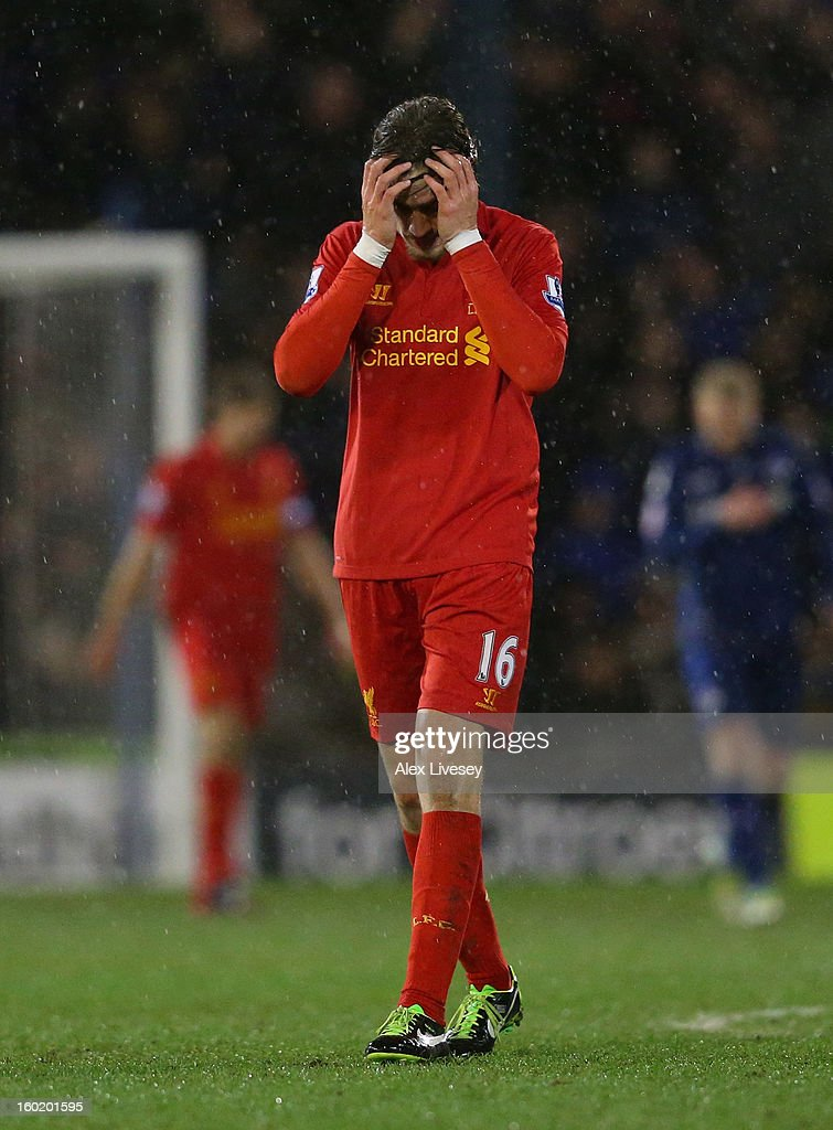 Sebastian Coates of Liverpool looks dejected during the FA Cup with Budweiser Fourth Round match between Oldham Athletic and Liverpool at Boundary Park on January 27, 2013 in Oldham, England.