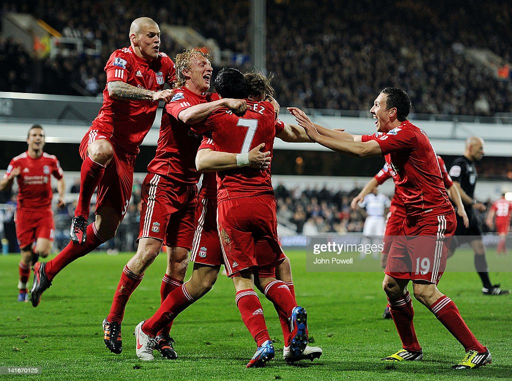 Sebastian Coates of Liverpool scores the opening goal during the Barclays Premier League match between Queens Park Rangers and Liverpool at Loftus Road on March 21, 2012 in London, England.