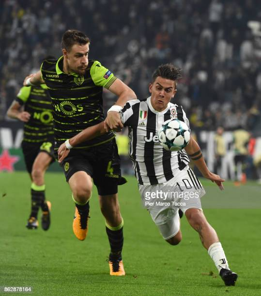 Sebastian Coates of Sporting CP competes for the ball with Paulo Dybala of Juventus during the UEFA Champions League group D match between Juventus...