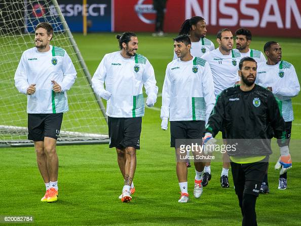Sebastian Coates of Sporting CP Luc Castaignos of Sporting CP Alan Ruiz of Sporting CP and teammates warm up during a training session ahead of their...
