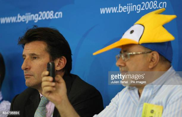 Sebastian Coe sitting beside a Portuguese fan wearing a Simpsons hat during the Final in the Fencing Hall of National Convention Center at the...