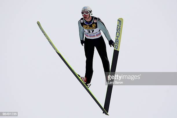 Sebastian Colloredo of Italy competes during training for the FIS Ski Jumping World Cup event at the 58th Four Hills ski jumping tournament at...