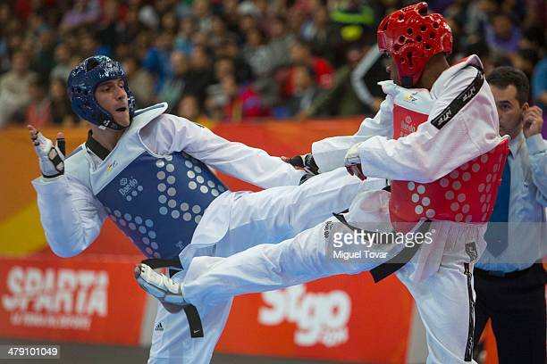 Sebastian Crismanich of Argentina competes with Giovero Sabajo of Suriname in taekwondo Men's 80kg Quarter Final combat during day ten of the X South...