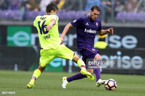 Sebastian Cristoforo of ACF Fiorentina battles for the ball with Adam Nagy of Bologna FC during the Serie A match between ACF Fiorentina and Bologna...