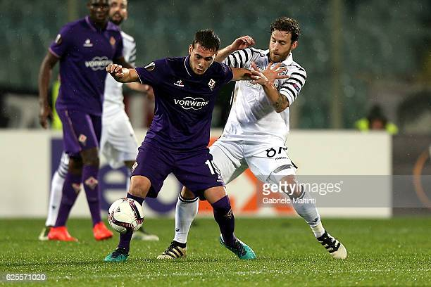 Sebastian Cristoforo of ACF Fiorentina battles for the ball with Jose Canas of PAOK FC during the UEFA Europa League match between ACF Fiorentina and...