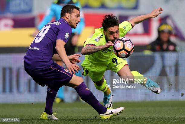 Sebastian Cristoforo of ACF Fiorentina battles for the ball with Simone Verdi of Bologna FC during the Serie A match between ACF Fiorentina and...