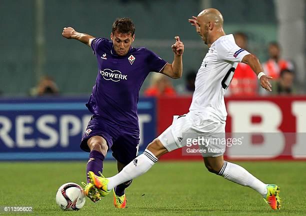 Sebastian Cristoforo of ACF Fiorentina fights for the ball with Richard Almeida of Qarabag FK during the UEFA Europa League match between ACF...