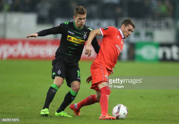 Sebastian Cristoforo of Fiorentina and Thorgan Hazard of Moenchengladbach battle for the ball during the UEFA Europa League Round of 32 first leg...