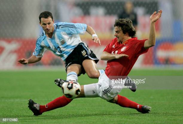 Sebastian Deisler of Germany challenges Lucas Bernardi of Argentina during the match between Argentina and Germany for the Confederations Cup 2005 at...