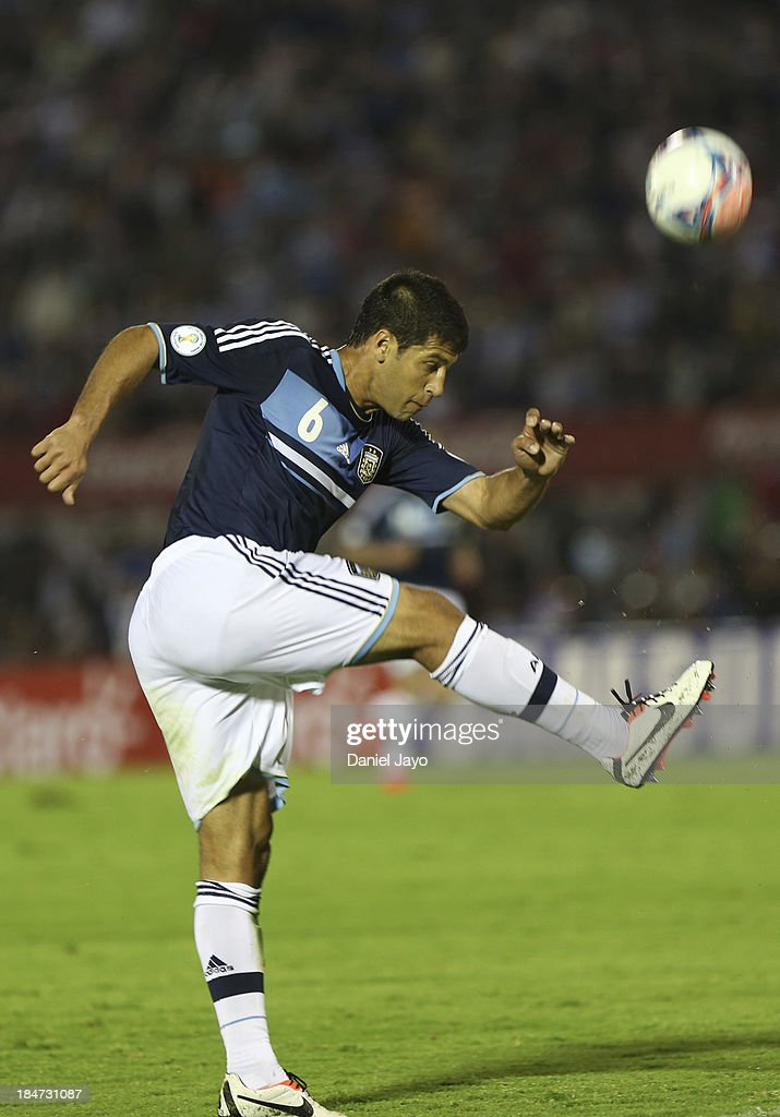 <a gi-track='captionPersonalityLinkClicked' href=/galleries/search?phrase=Sebastian+Dominguez&family=editorial&specificpeople=2474032 ng-click='$event.stopPropagation()'>Sebastian Dominguez</a> of Argentina kicks the ball during a match between Uruguay and Argentina as part of the 18th round of the South American Qualifiers at Centenario Stadium on October 15, 2013 in Montevideo, Uruguay.