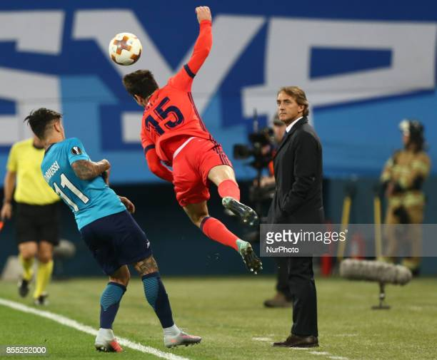 Sebastian Driussi of FC Zenit Saint Petersburg and Aritz Elustondo of FC Real Sociedad vie for the ball during the UEFA Europa League Group L...
