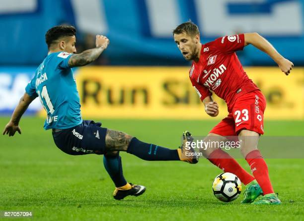 Sebastian Driussi of FC Zenit Saint Petersburg and Dmitri Kombarov of FC Spartak Moscow vie for the ball during the Russian Football League match...