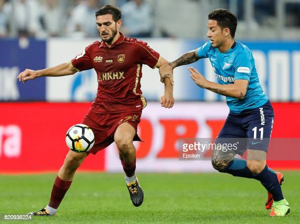 Sebastian Driussi of FC Zenit Saint Petersburg and Magomed Ozdoev of FC Rubin Kazan vie for the ball during the Russian Football League match between...