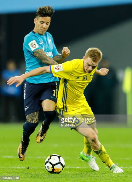 Sebastian Driussi of FC Zenit Saint Petersburg and Pavel Mogilevets of FC Rostov vie for the ball during the Russian Football League match between FC...
