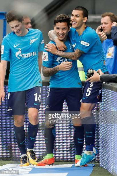 Sebastian Driussi of FC Zenit Saint Petersburg celebrates his goal with Daler Kuzyaev of FC Zenit Saint Petersburg and Leandro Paredes of FC Zenit...