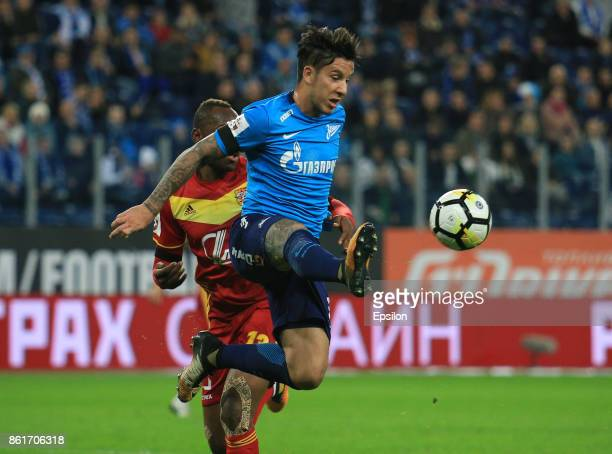 Sebastian Driussi of FC Zenit St Petersburg vies for the ball with Stophira Sunzu of FC Arsenal Tula during the during the Russian Premier League...