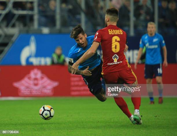 Sebastian Driussi of FC Zenit St Petersburg vies for the ball with Maxim Belyaev of FC Arsenal Tula during the during the Russian Premier League...