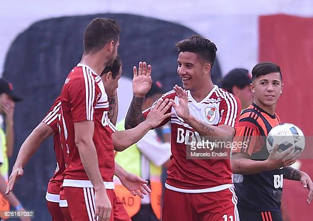 Sebastian Driussi of River Plate and teammates celebrate after scoring the first goal of their team during a match between River Plate and Huracan as...