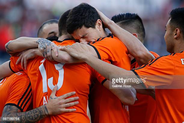 Sebastian Driussi of River Plate celebrates with teammates after scoring the opening goal during a match between River Plate and Banfield as part of...
