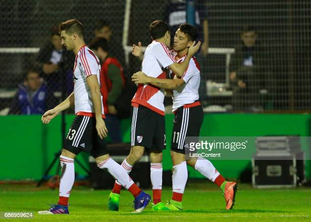 Sebastian Driussi of River Plate celebrates with teammates Lucas Alario and Camilo Mayada after scoring the first goal of his team during a match...