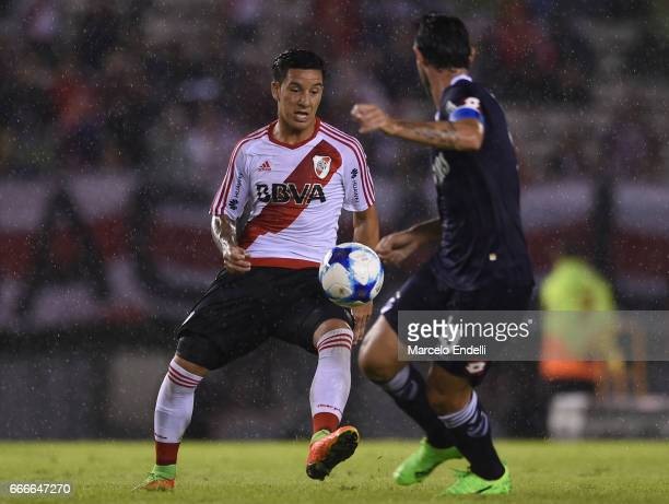Sebastian Driussi of River Plate fights for ball with Diego Colotto of Quilmes during a match between River Plate and Quilmes as part of Torneo...