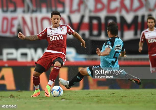 Sebastian Driussi of River Plate fights for ball with Guillermo Farre of Belgrano of River Plate during a match between River Plate and Belgrano as...