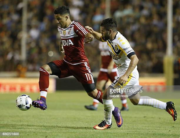 Sebastian Driussi of River Plate fights for the ball with Carlos Rodriguez of Olimpo during a match between Olimpo and River Plate as part of Torneo...