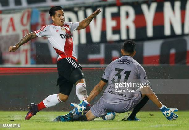 Sebastian Driussi of River Plate fights for the ball with Esteban Andrade of Lanus during a match between River Plate and Lanus as part of Supercopa...