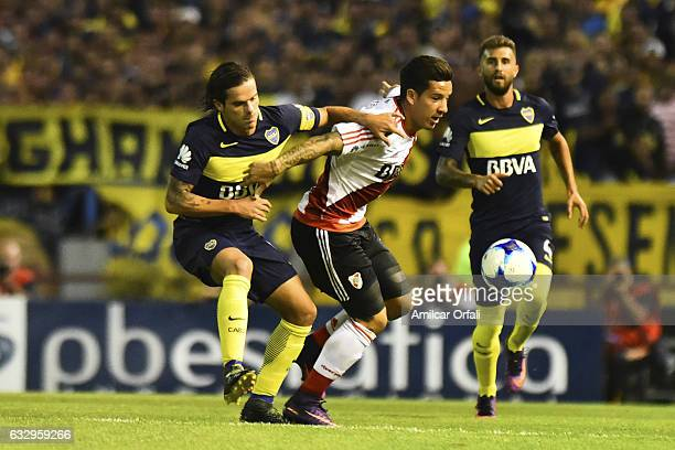 Sebastian Driussi of River Plate fights for the ball with Fernando Gago of Boca Juniors during a match between Boca Juniors and River Plate as part...