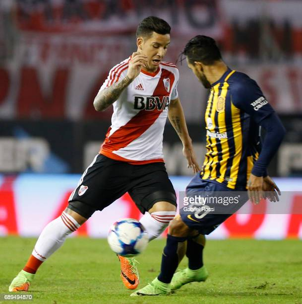 Sebastian Driussi of River Plate fights for the ball with Gustavo Colman of Rosario Central during a match between River Plate and Rosario Central as...
