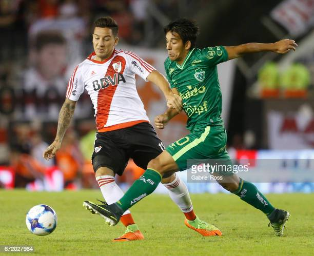 Sebastian Driussi of River Plate fights for the ball with Hamilton Pereira of Sarmiento during a match between River Plate and Sarmiento as part of...