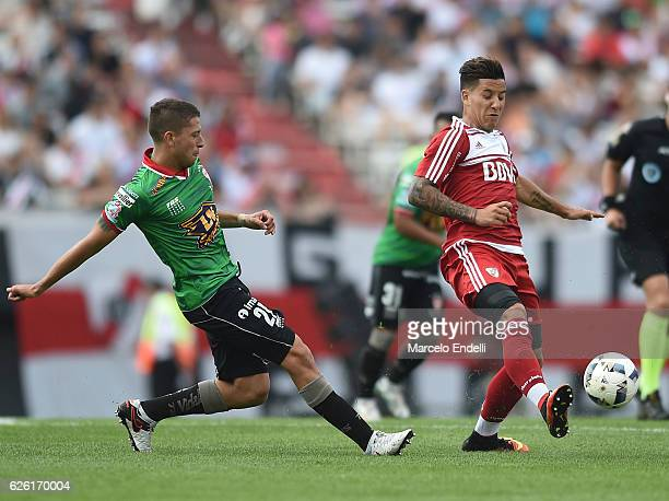 Sebastian Driussi of River Plate fights for the ball with Hugo Nervo of Huracan during a match between River Plate and Huracan as part of Torneo...