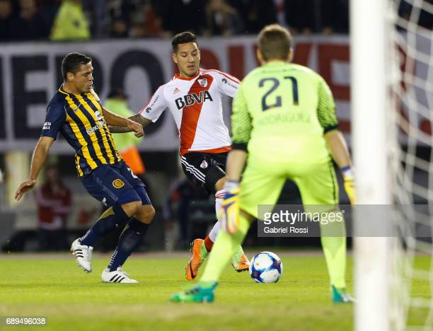 Sebastian Driussi of River Plate fights for the ball with Jose Leguizamon of Rosario Central during a match between River Plate and Rosario Central...