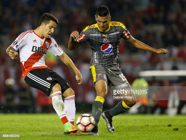 Sebastian Driussi of River Plate fights for the ball with Juan Saiz of Independiente Medellin during a group stage match between River Plate and...