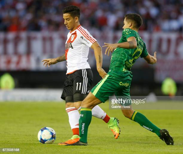 Sebastian Driussi of River Plate fights for the ball with Lucas Perez Godoy of Sarmiento during a match between River Plate and Sarmiento as part of...