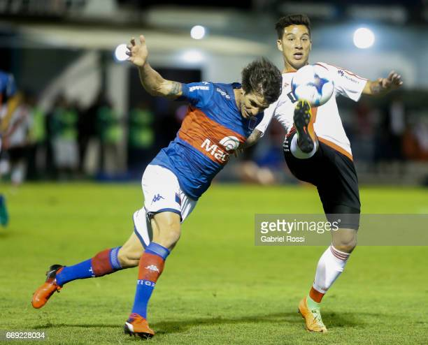 Sebastian Driussi of River Plate fights for the ball with Martin Galmarini of Tigre during a match between Tigre and River Plate as part of Torneo...