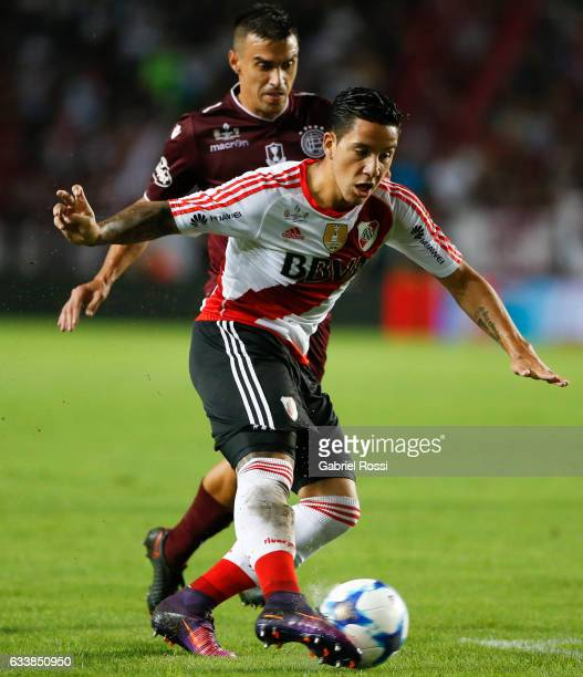 Sebastian Driussi of River Plate fights for the ball with Maximiliano Velazquez of Lanus during a match between River Plate and Lanus as part of...