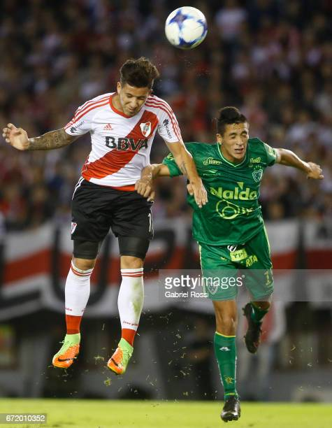 Sebastian Driussi of River Plate fights for the ball with Maximiliano Mendez of Sarmiento during a match between River Plate and Sarmiento as part of...