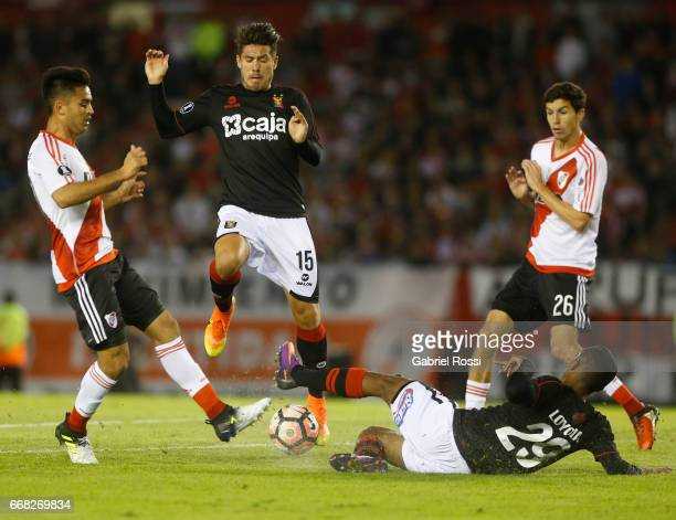 Sebastian Driussi of River Plate fights for the ball with Nilson Loyola of Melgar during a match between River Plate and FBC Melgar as part of Copa...